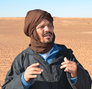 Beisat explains Morocco's Wall (in background) during 2014 visit to Western Sahara