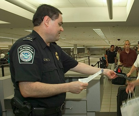 Armed US airport passport control officer on the job