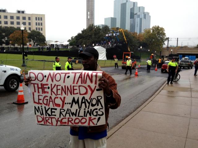 "Benny Jeffery protests Dallas mayor Mike Rawlings' decision to pave over the ""X"" which marks the spot of President Kennedy's death."