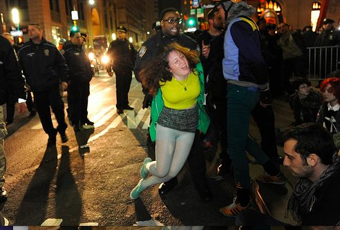 Image of Cecily McMillan being arrested as the NYPD clears Zuccotti Park during a six-month memorial celebration of the Occupy M