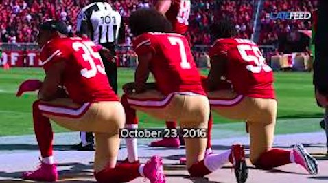 Colin Kaepernick (center) takes a knee in protest, loses his ability to play pro ball, but starts a movement