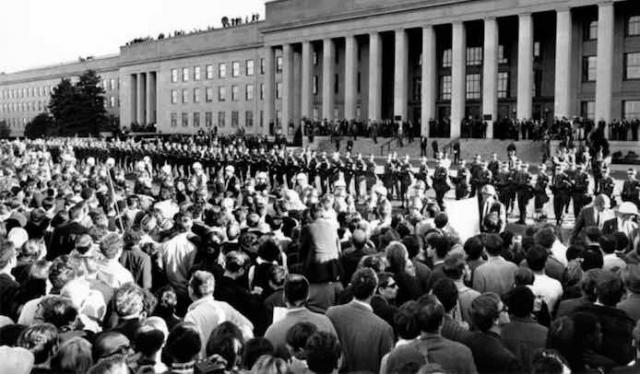 hundreds of thousands of protesters confront the US War Machine on Oct. 21, 1967 as Generals and DOD leaders watch from the Pentagon the roof