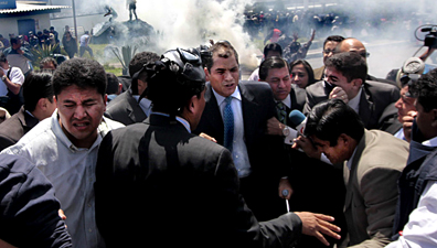 President Rafael Correa, center, during the confrontation with rebel police officers