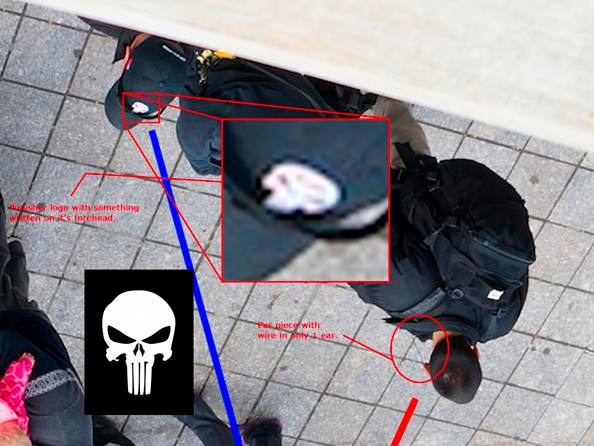 Craft mercenaries on the scene at the Boston Marathon, their hats bearing the company's logo, magnified here