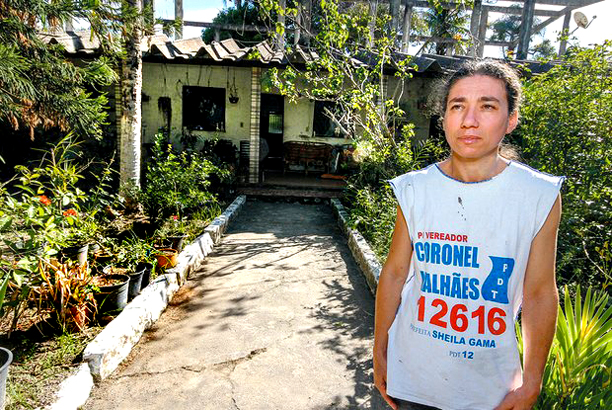 Cristina Batista Malhaes wearing a t-shirt for her dead husband's campaign for public office