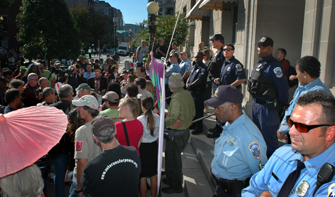 A shot taken of the crowd and the cops from the Chamber's flower patch