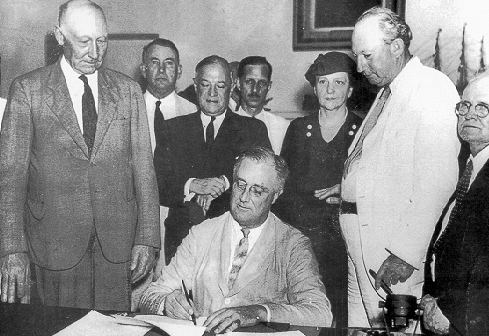 President Roosevelt signs the Social Security Act in 1935, providing retirement security for the next 77 years and beyond