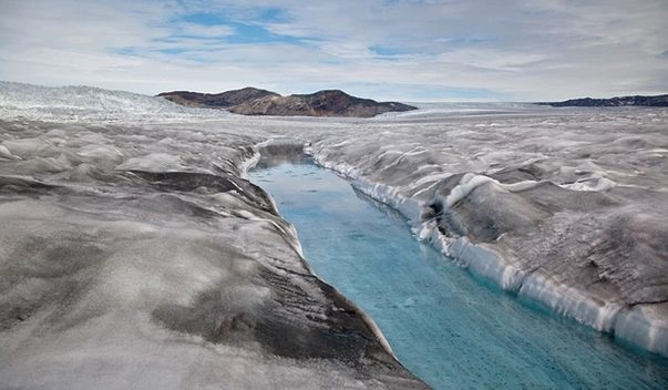 As global warming melts Greenland's massive ice cap, its surface exposes centuries of soot and ash, becoming ever darker and melting ever faster -- just one of myriad vicious climate change circles.