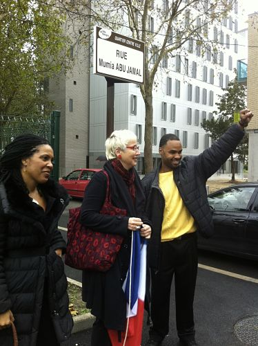 One of Abu-Jamal's sons - Jamal - (right) at street naming ceremony in a suburb of Paris. -LBWPhoto