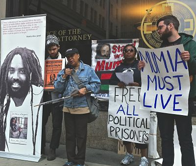 Pam Africa (with mic) and Abu-Jamal supporters protest outside office of Philadelpia's DA. -LBWPhoto