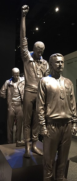 Legendary athletes/activists Tommy Smith (middle) and John Carlos (rear). LBWPhoto