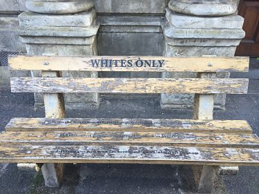 Bench on porch of Donald Trump? No. Apartheid-era artifact in downtown Capetown, South Africa. LBWPhoto