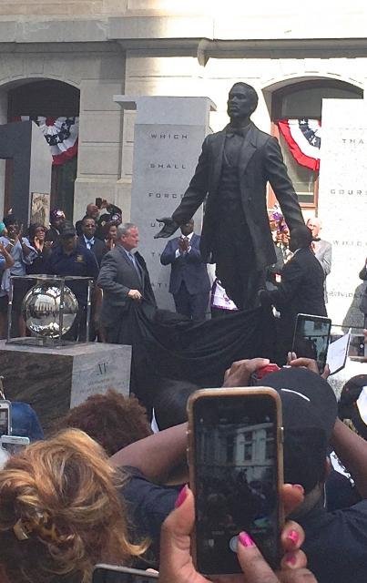 Philadelphia Mayor James Kenny (r) and sculptor Branly Cadet unveil statue of Octavius Catto. LBWPhoto