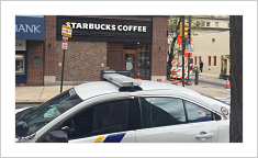 Philadelphia police car outside Starbucks location of infamous 4/12/18 arrest incident. PhotoLBW