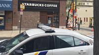 Philadelphia police car outside Starbucks location of infamous 4/12/18 arrest incident. PhotoLBW