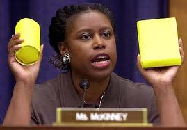 Former Congresswoman Cynthia McKinney on Libyan state TV displaying anti-personnel weapons dropped by NATO forces..