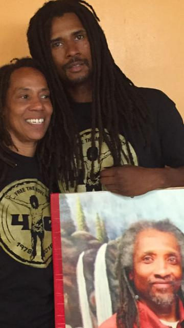 Debbie Africa with son Mike Jr. and photo of still imprisoned husband/father Mike Africa Sr. LBWPhoto