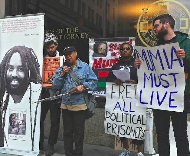 Mumia supporters protest at the office of the Philadelphia District Attorney, which retired Justice Ron Castille headed for four hears