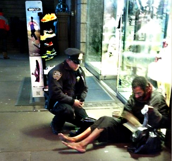 Jennifer Foster's cell phone image of Officer Lawrence DePrimo and a homeless man on Times Square