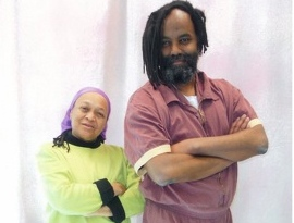 Pam Africa with Mumia Abu-Jamal following the latter's transfer from Pennsylvania's death row to the general prison population