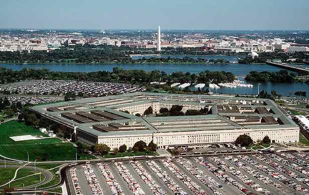 The Pentagon, world's largest office building, surrounded by parking lots for the warmakers