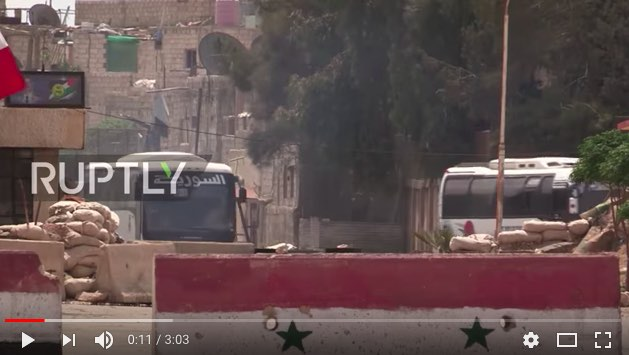Rebels fleeing Douma by bus caravan under a Russian-negotiated 'safe passage' agreement