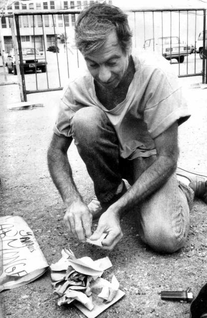 Author Ron Ridenour burns his US Passport in front of US Special Interests Section building in Havana