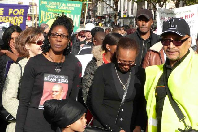 March participants Rigg and Bennett whose brothers died in police custody, at protest march (photo by Washington)