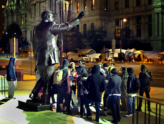 Occupiers discuss their occupation under the statue of Frank Rizzo across from Philadelphia City Hall (John Grant)