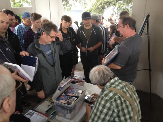 Noted JFK conspiracy author and expert Robert Groden holds court in Dealey Plaza.