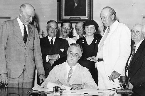 President Roosevelt signes the Social Security Act int