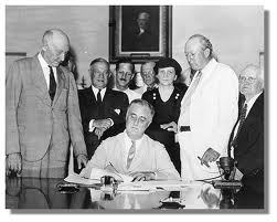 Pres. Franklin Roosevelt signs the Social Security Act into law