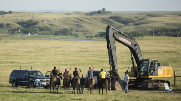 Native people blocking construction of an oil pipeline across Sioux sacred lands