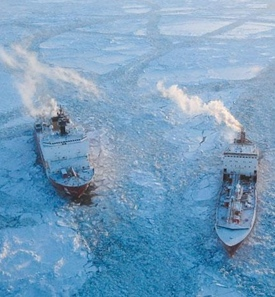 Coast Guard vessels patrolling in a melting Arctic Ocean (Pentagon photo)