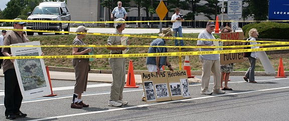 Protesters ran crime scene tape across the Lockheed Martin entrance before being busted (photos by Brandywine Peace Community)