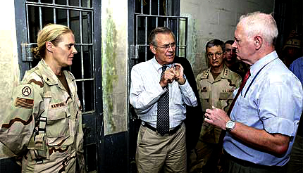 Defense Secretary Donald Rumsfeld at Abu Ghraib, where he ordered rough treatment for Iraqis.