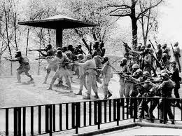 Ohio Guardsmen firing live ammunition at peaceful, unarmed Kent State U. student demonstrators in 1970