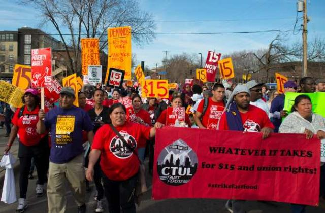 Workers picketing for a $15/hour minimum wage.